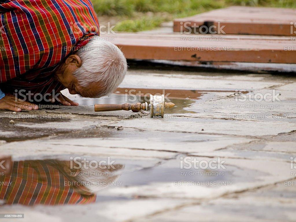 Older man praying to Buddha stock photo