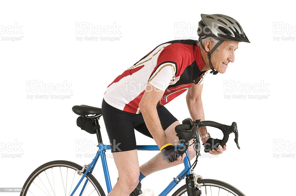 Older man riding bike for fitness royalty-free stock photo