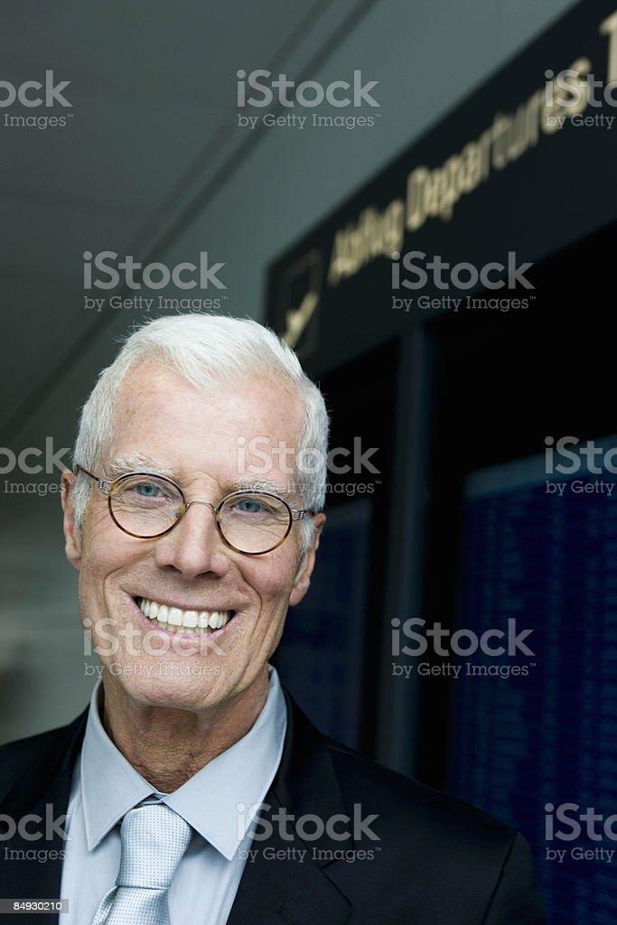 Older man smiling at viewer stock photo