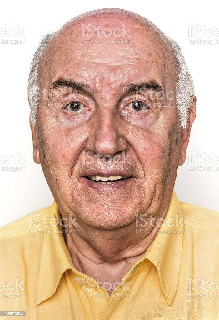 Older man smiling in front of a white background. royalty-free stock photo