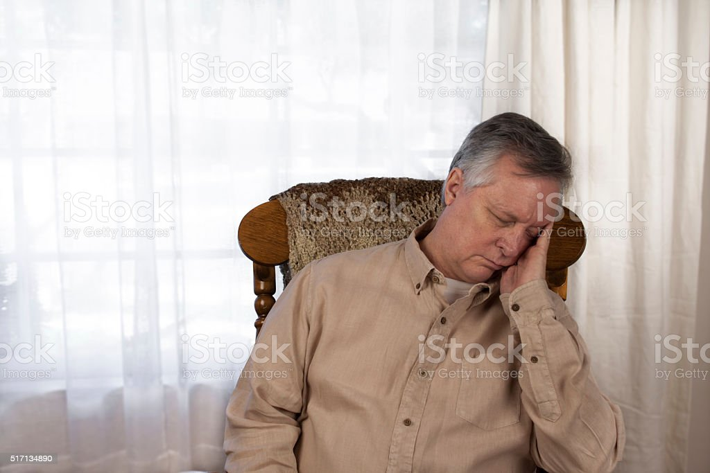 Older Man Suffering from Fatigue stock photo