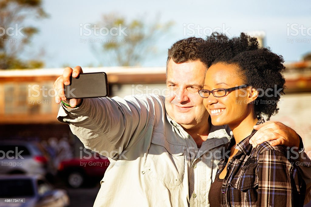 Older man takes selfie with African American student stock photo