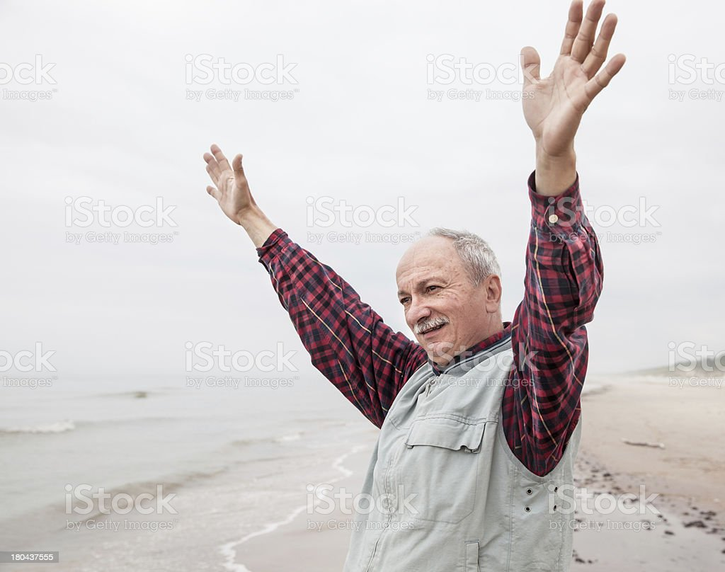 older man with outstretched arms the coast royalty-free stock photo