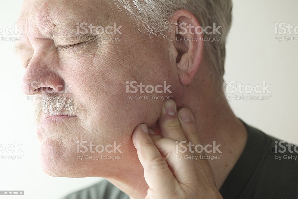 Older man with painful jaw stock photo