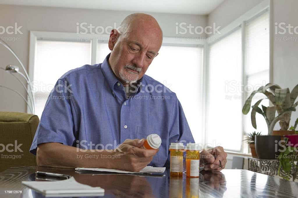 Older man with prescription medications stock photo