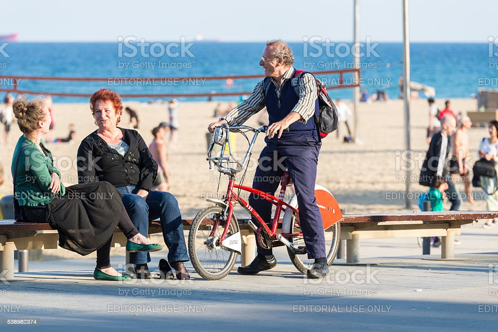 Older people talking happily, Barcelona stock photo