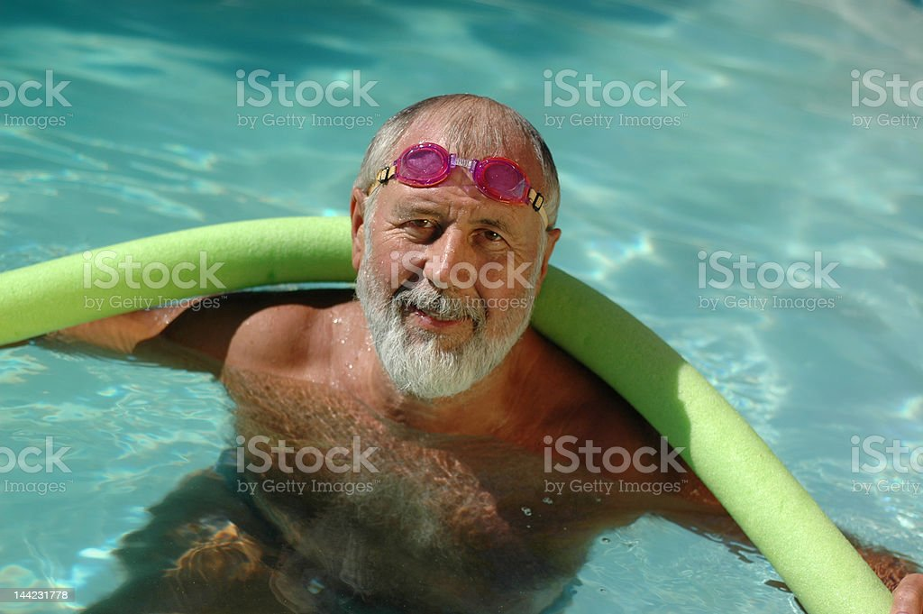Older swimmer in the pool royalty-free stock photo