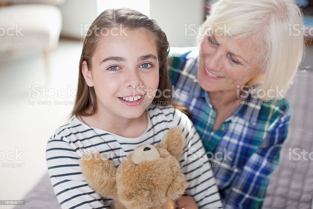 Older woman and granddaughter sitting together royalty-free stock photo