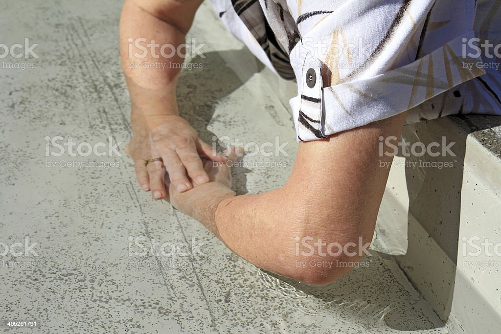older woman bathing forearms stock photo