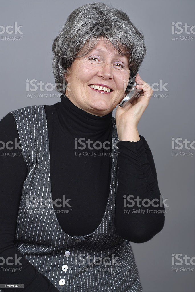 Older woman calling royalty-free stock photo