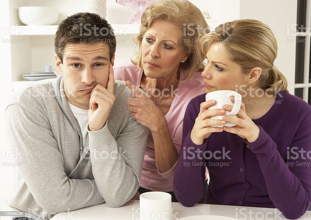 Older woman in between young woman and young man stock photo
