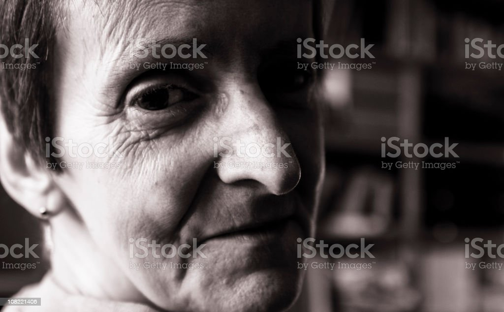 Older Woman Looking Over Shoulder, Black and White Portrait royalty-free stock photo