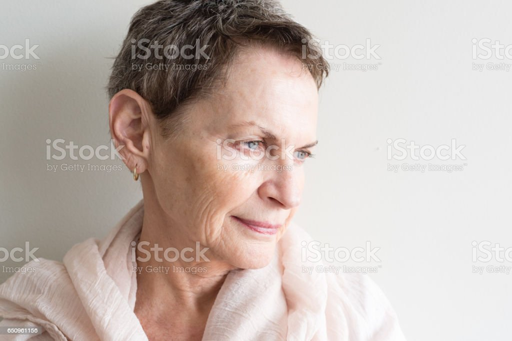 Older woman looking pensive close up stock photo