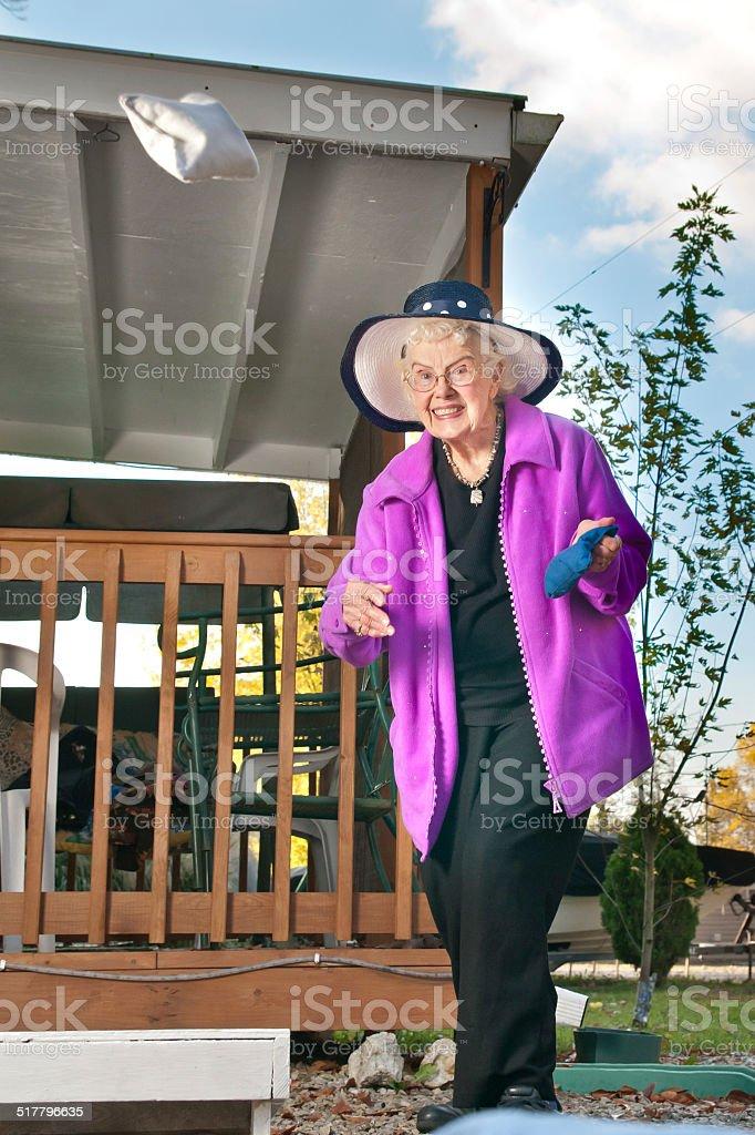 Older woman playing Cornhole stock photo