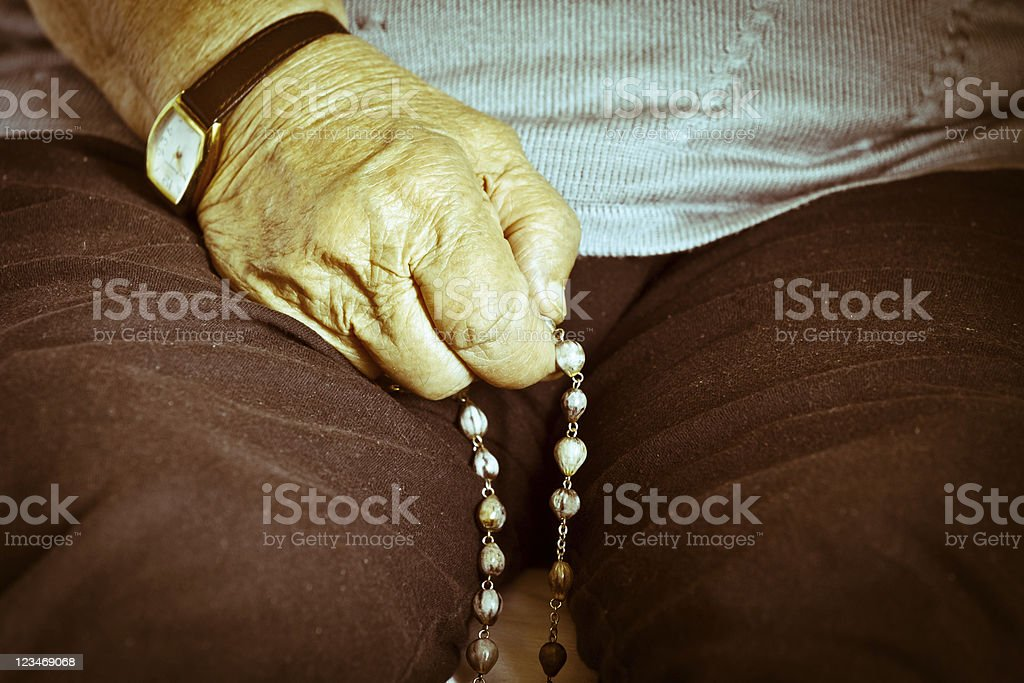 Older Woman Praying royalty-free stock photo