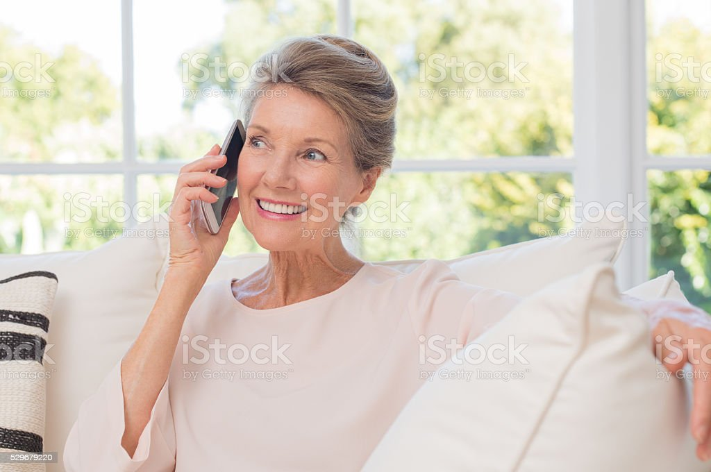 Older woman talking on phone stock photo