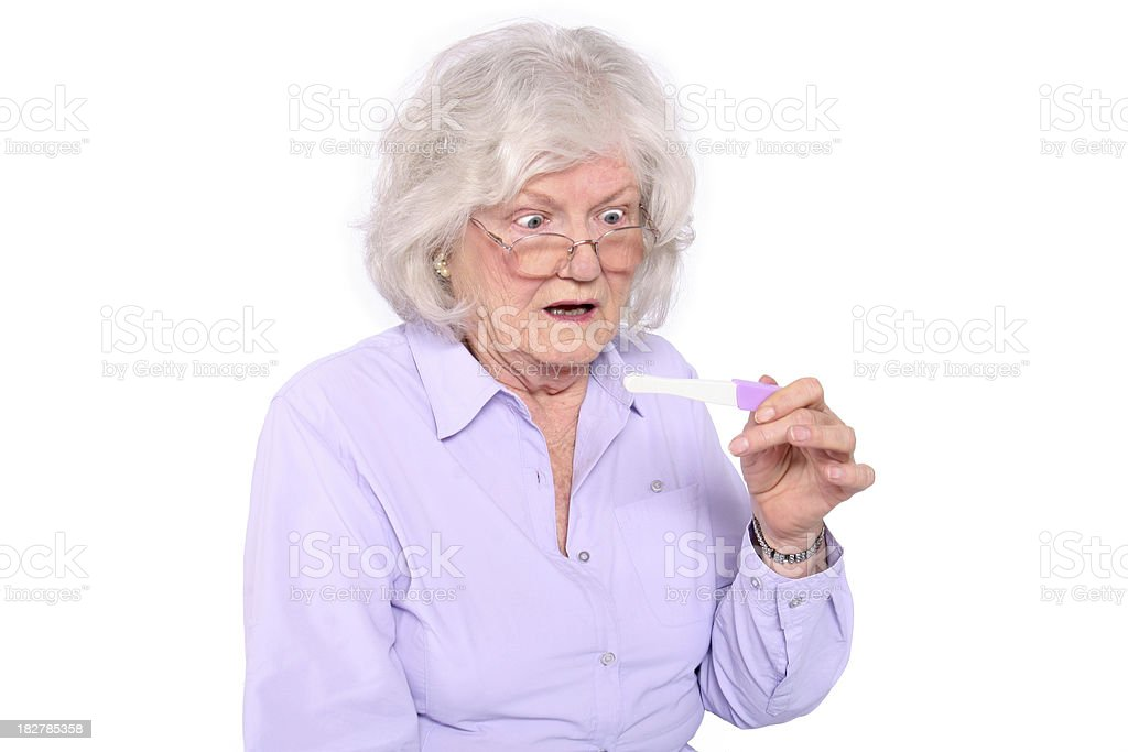 Older woman with pregnancy test royalty-free stock photo