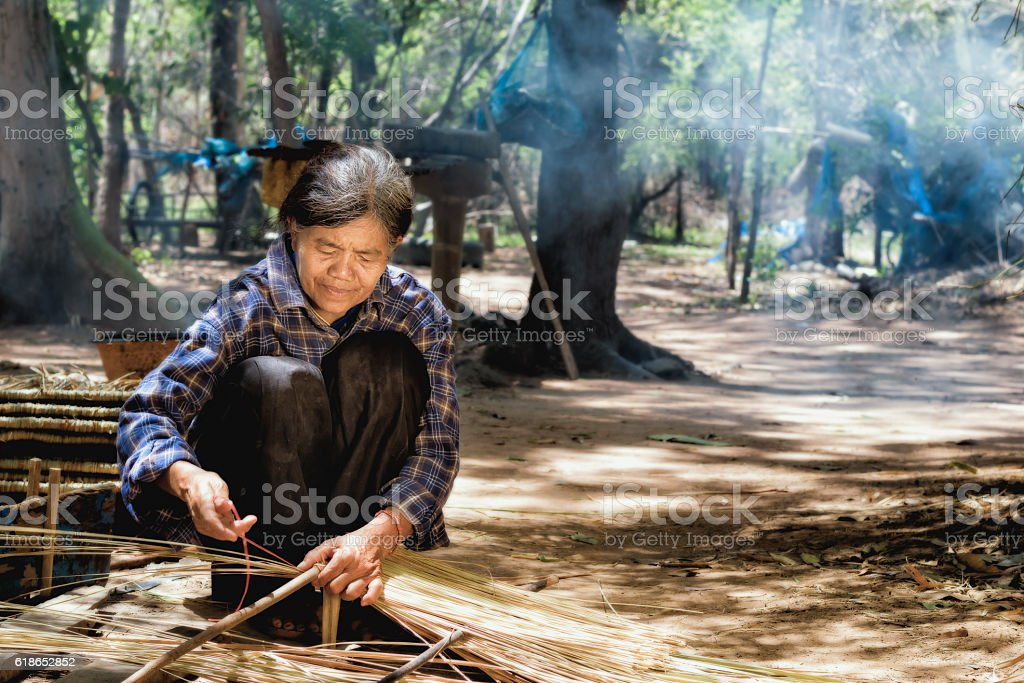 Older women in Asia are using mortars in traditional Asian cooking. stock photo