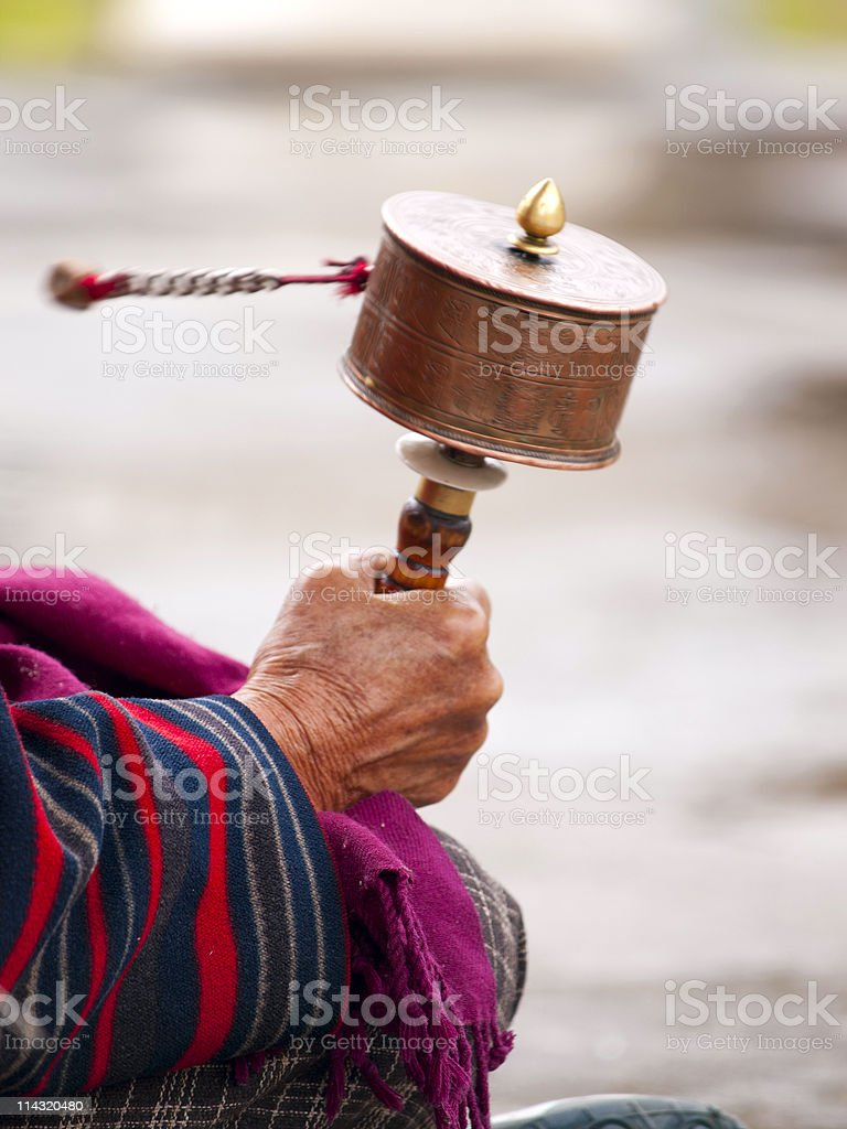 Older women spinning her prayer wheel royalty-free stock photo