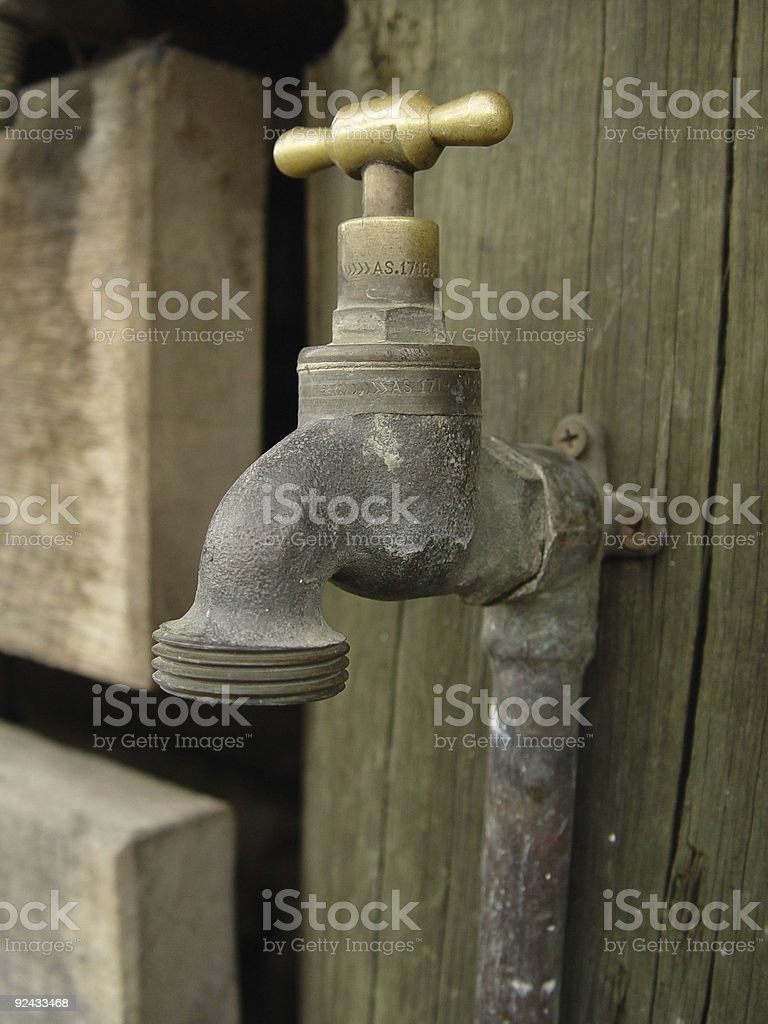 old-fashion faucet on the beach stock photo