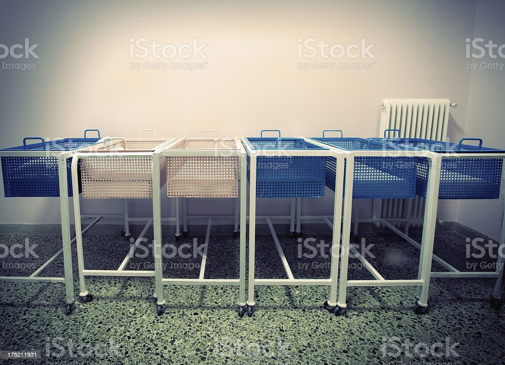 Old-fashioned baby cots stock photo