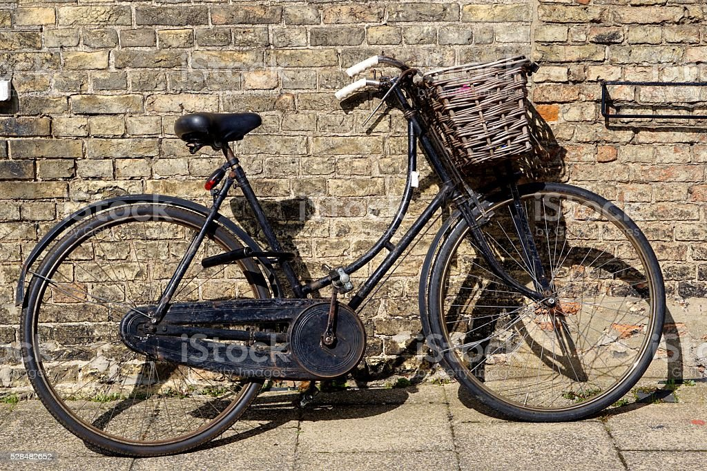 Old-Fashioned Black Bicycle With Basket stock photo