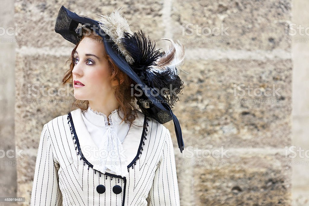 Old-fashioned dressed woman with wandering gaze royalty-free stock photo