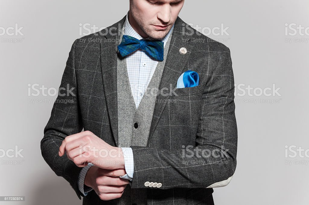 Old-fashioned elegance man wearing tweed jacket and vest stock photo