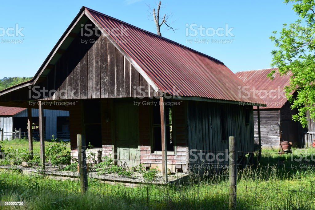 Old-fashioned farmers house in the countryside stock photo