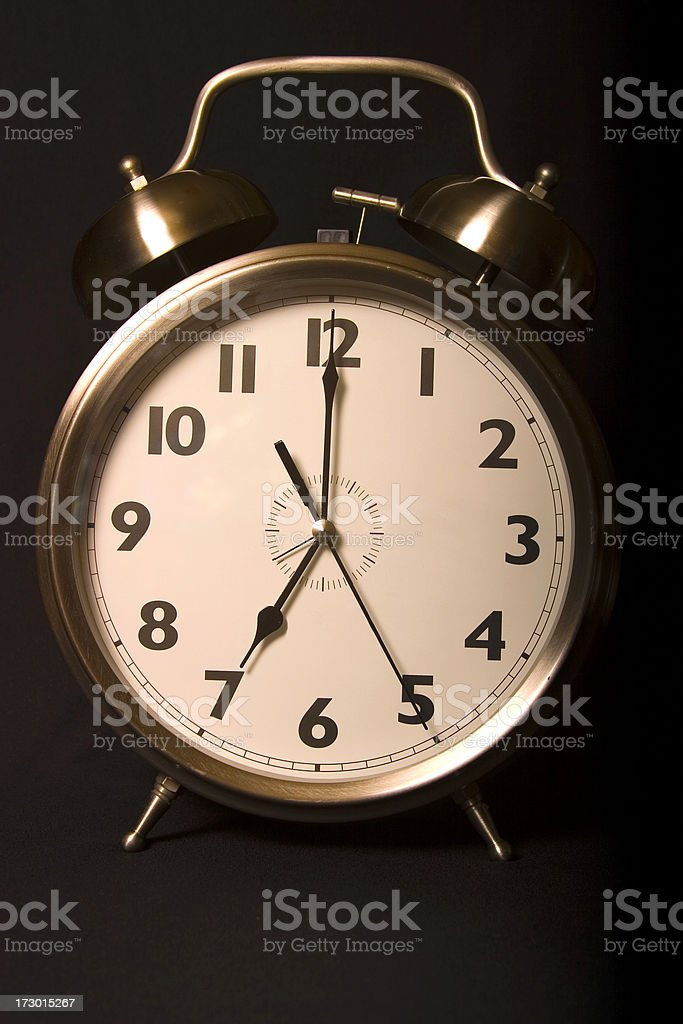 Old-fashioned iconic alarm clock - seven stock photo