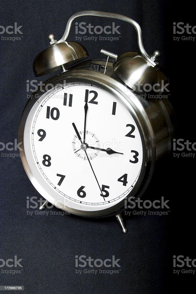 Old-fashioned iconic alarm clock - three stock photo