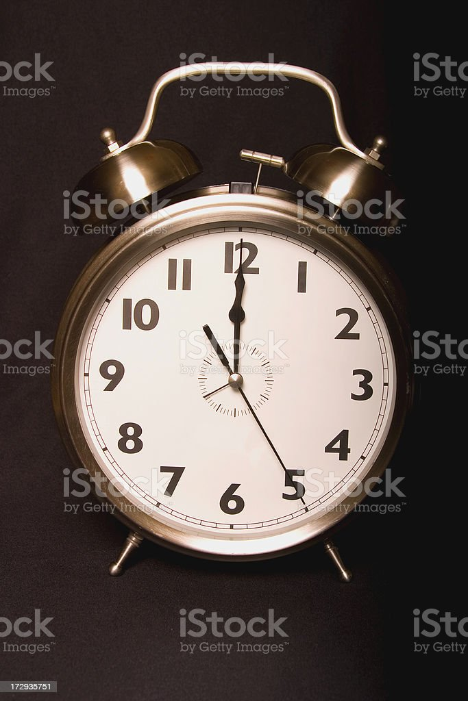 Old-fashioned iconic alarm clock - twelve NOON or MIDNIGHT stock photo