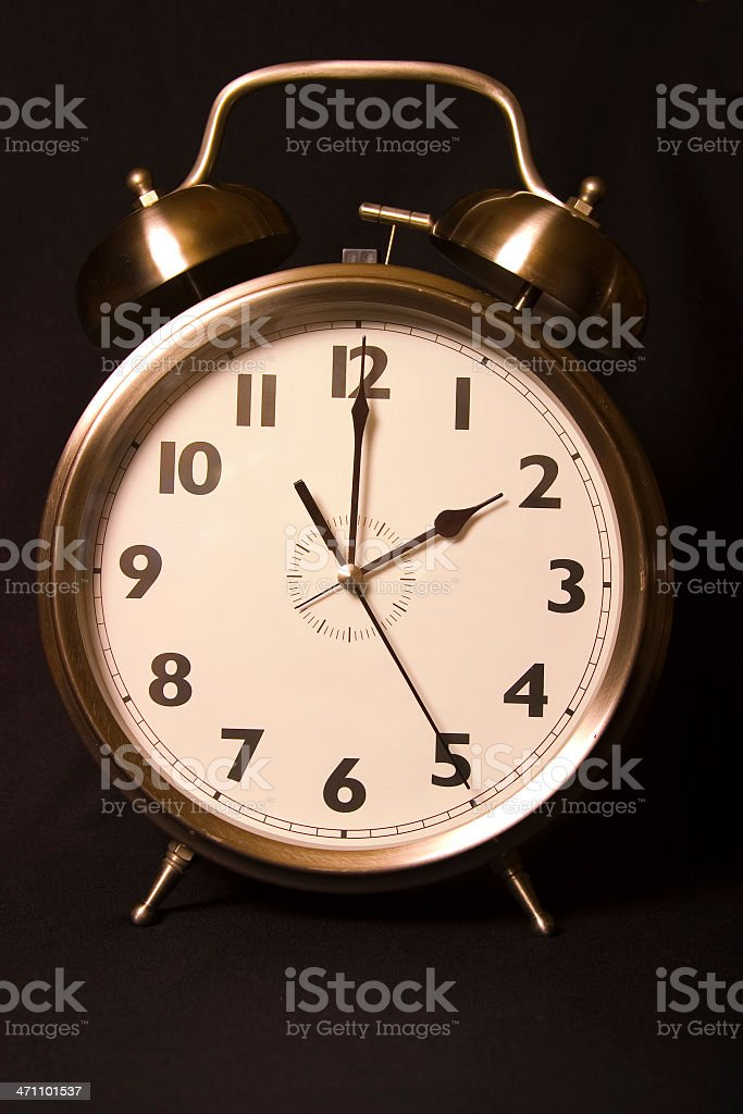 Old-fashioned iconic alarm clock -two o'clock - head-on stock photo