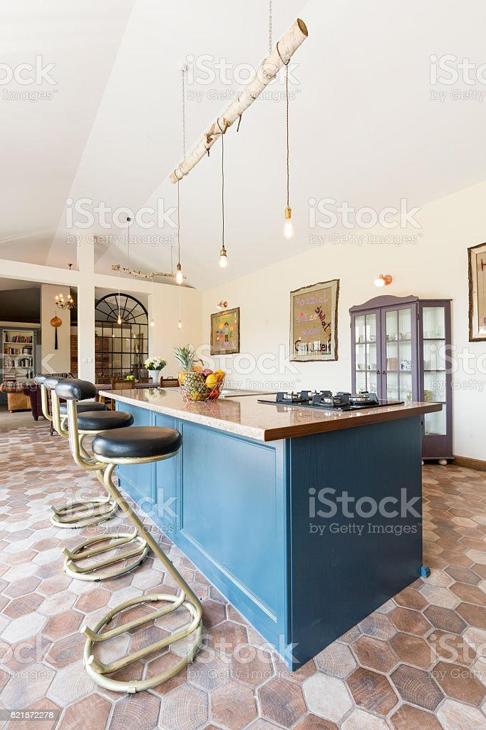 Old-fashioned kitchen with blue furniture stock photo