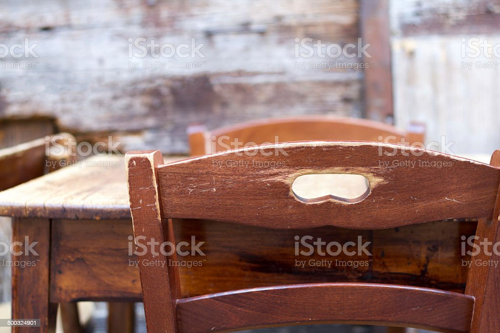 Old-Fashioned, Rustic Wooden Chairs and Table, Outdoors stock photo