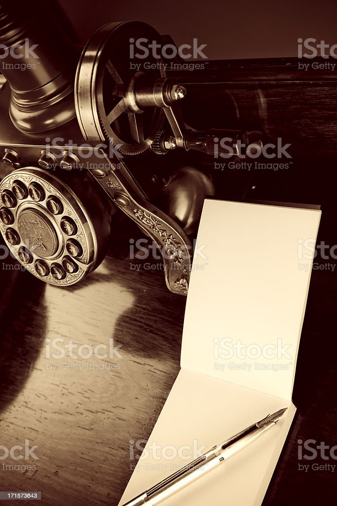 Old-fashioned Telephone And Writing Pad royalty-free stock photo