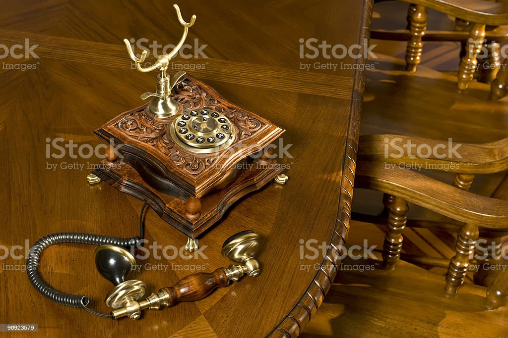 Old-fashioned telephone on table stock photo