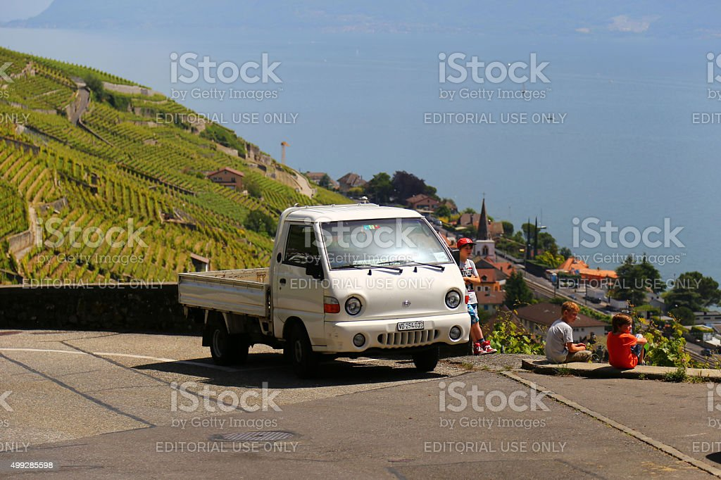 Old-fashioned truck and kids around in Cully, Switzerland stock photo