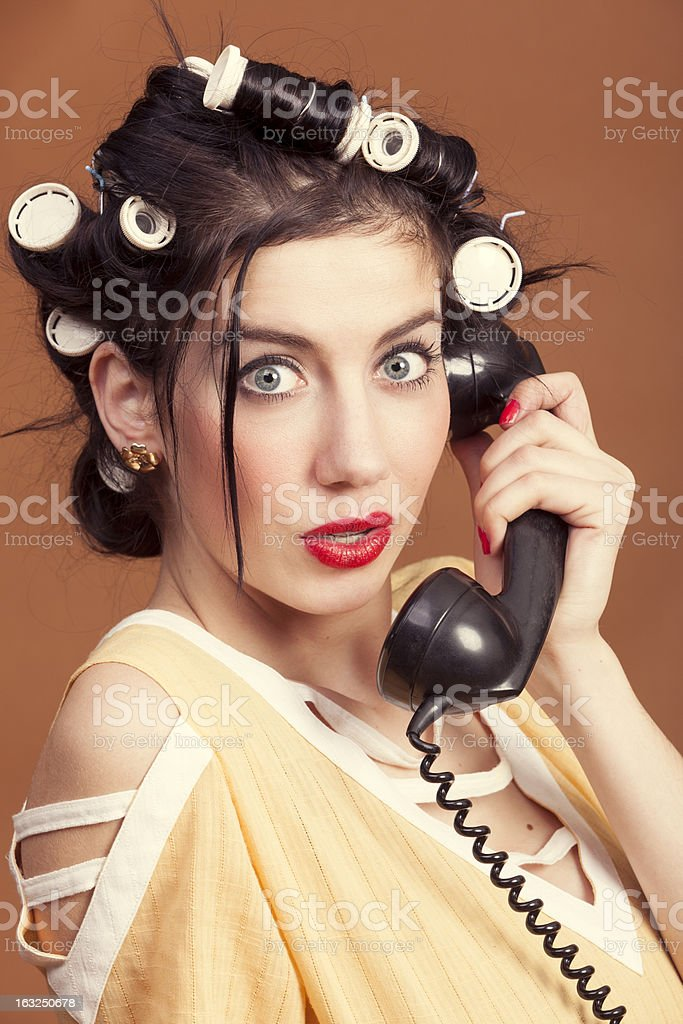 Old-fashioned woman with old telephone royalty-free stock photo