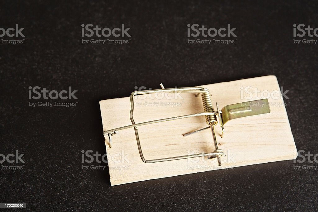 Old-fashioned wooden mousetrap on black background stock photo
