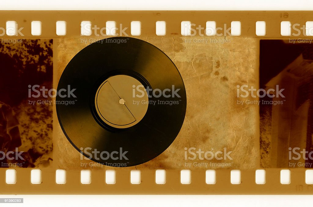oldies 35mm frame photo with vintage vinyl disk royalty-free stock photo