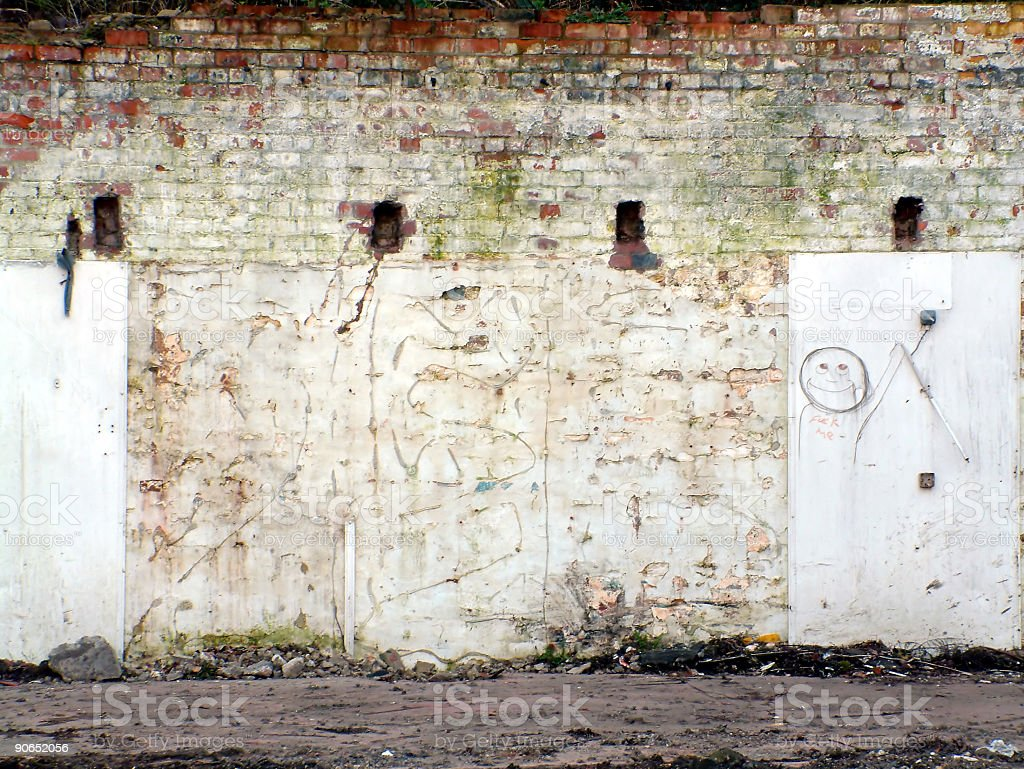 Old-looking distressed wall with street drawings stock photo