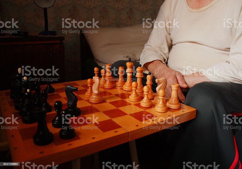 oldman thinking chess strategy in nursing home, closeup stock photo