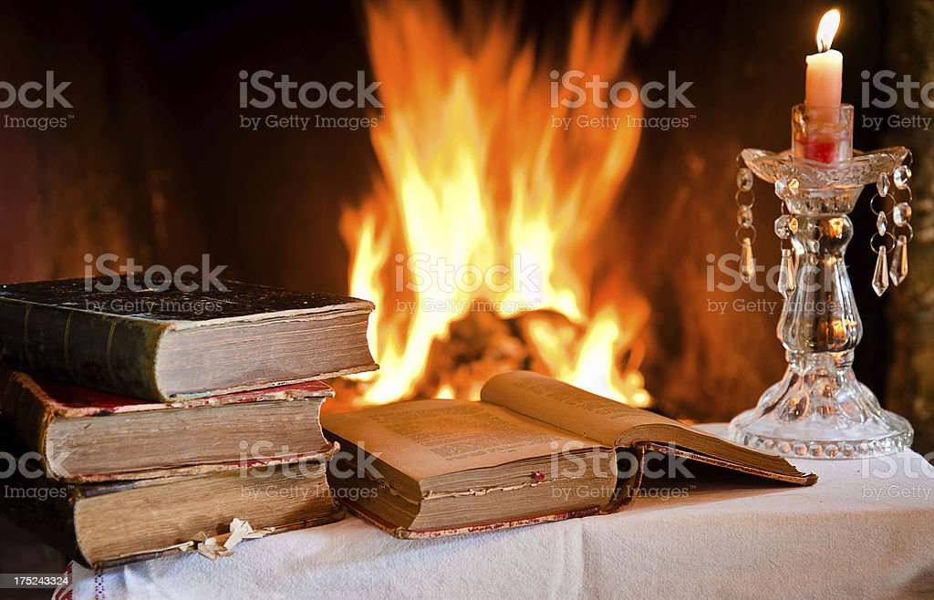 Olds Books by the fire royalty-free stock photo
