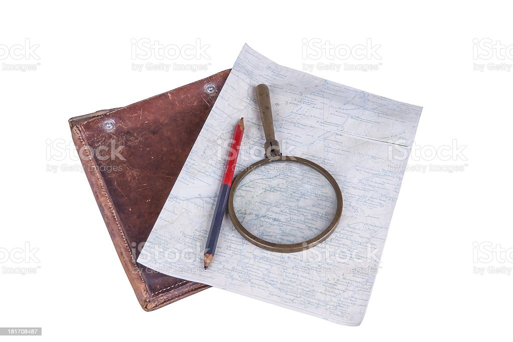 old-style home-made map with magnifier, pencil and leather case stock photo