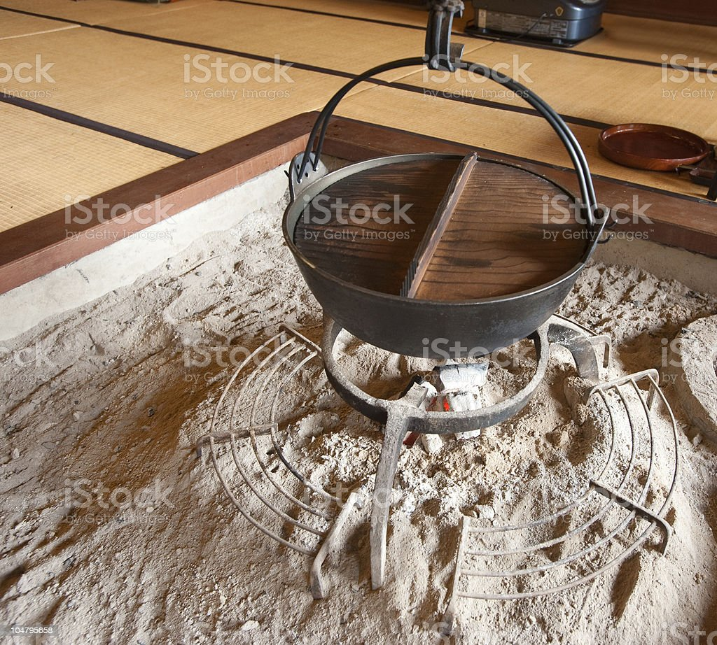 Old-style Japanese cooking pot over coals royalty-free stock photo