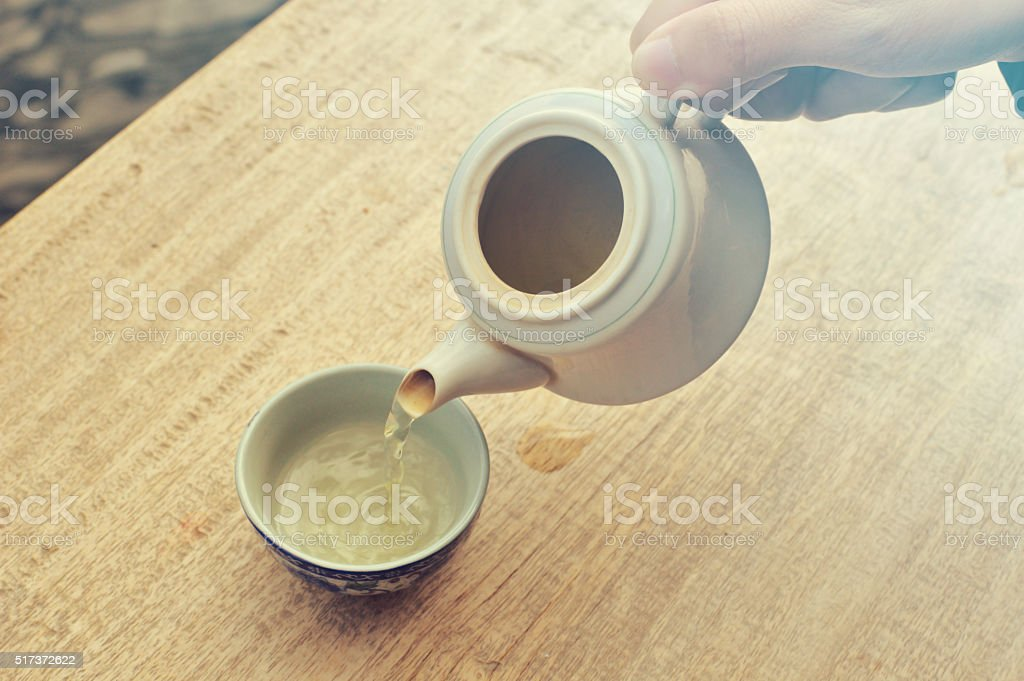 Old-style  kettle and Chinese glasses tea on the wood table stock photo
