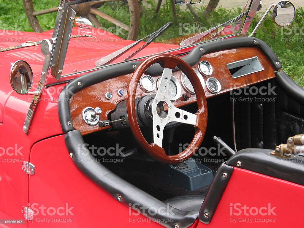Oldstyle red car's cocpit stock photo
