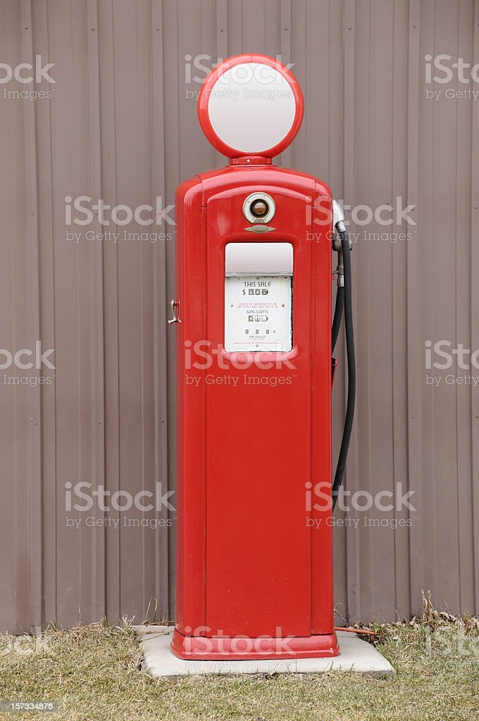 Old-Style Retro Antique Red Gas Petroleum Fuel Pump, Outdoors, Isolated stock photo