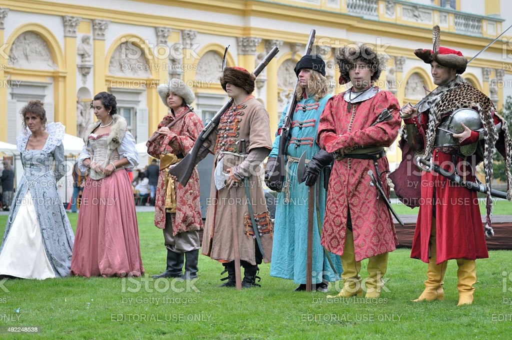 Old-time nobility costumes stock photo